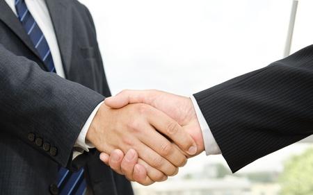 Male handshake on business background