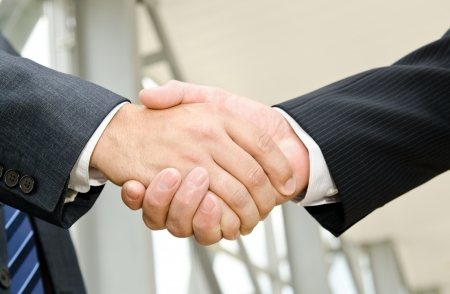 Male handshake on business background