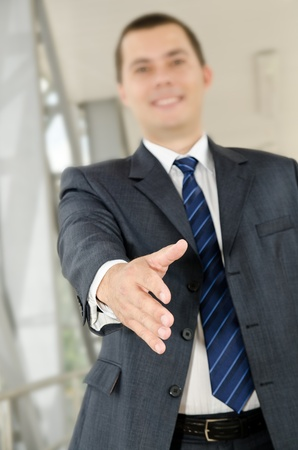 reached: Businessman male hand reached to seal the agreement on business background Stock Photo