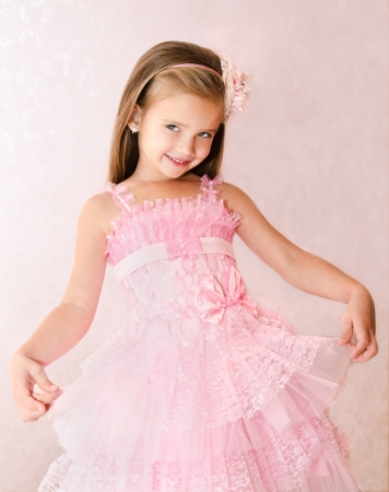 Portrait of cute smiling little girl in princess dress  photo
