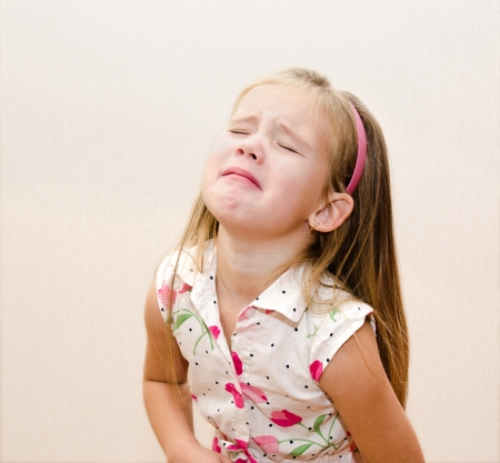 Portrait of disobedient crying little girl