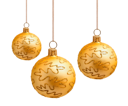Perfect golden christmas balls isolated on white background photo