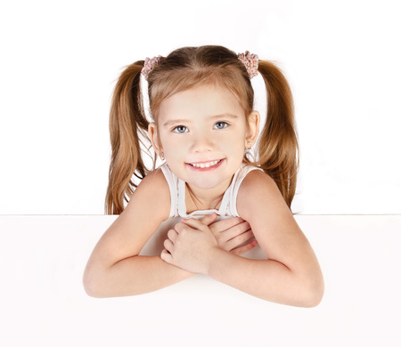 cute little girls: Smiling cute little girl isolated on white Stock Photo