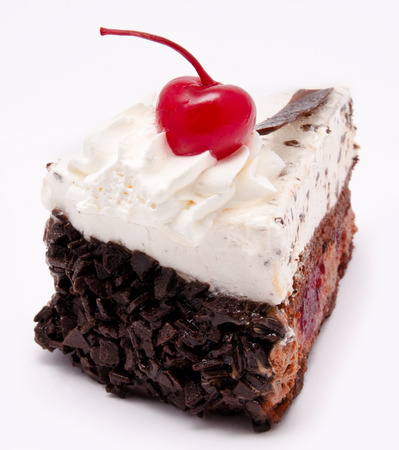 Slice of chocolate cake with cherry on the top isolated on a white background photo