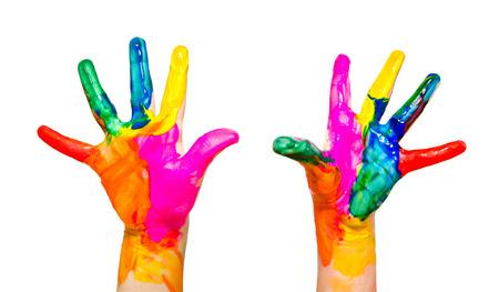 Manos pintadas del niño colorido divertido aislado en el fondo blanco Foto de archivo - 25115889