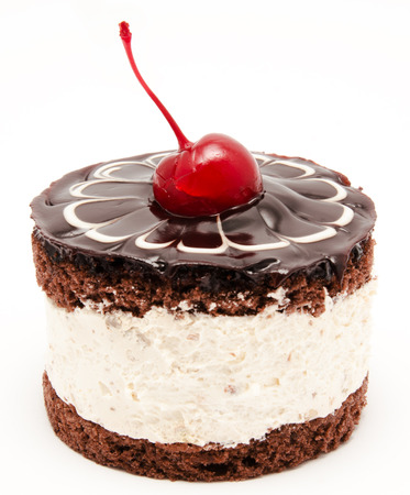 Chocolate cake with cherry on the top icing isolated on a white background