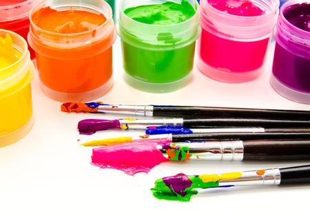 Gouache paint brushes isolated on a white background photo