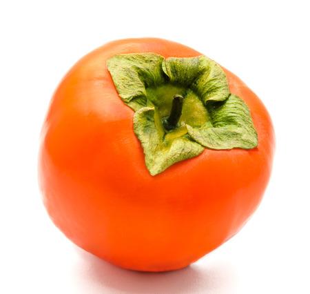 persimmon: Caqui maduro anaranjado aislado en un fondo blanco Foto de archivo
