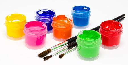Gouache paint brush isolated on a white background photo