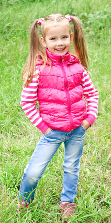outumn: Portrait of adorable smiling little girl outdoor