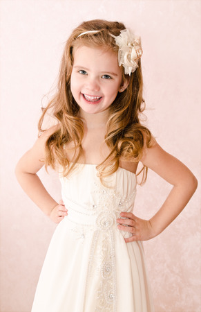 Happy adorable little girl in princess dress isolated