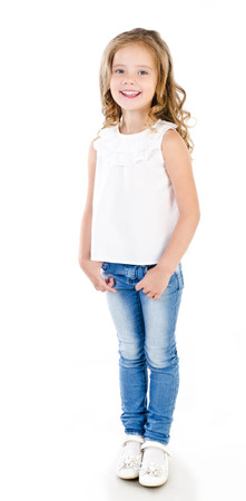 Cute smiling little girl in jeans isolated on white Imagens
