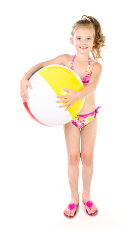 little girl swimsuit: Cute smiling little girl in swimsuit holding ball isolated on a white Stock Photo