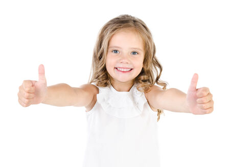 two thumbs up: Happy cute little girl with two finger up isolated on a white Stock Photo