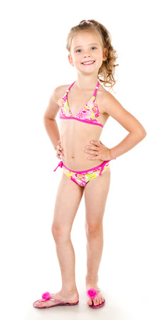 Cute smiling little girl in swimsuit isolated on a white photo