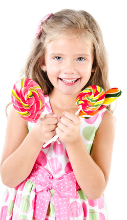Happy little girl with lollipops isolated on a white photo