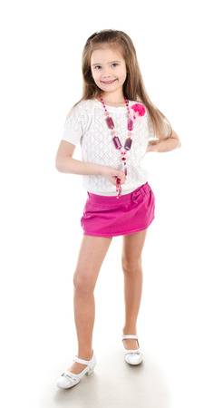skirts: Smiling adorable little girl in skirt with beads isolated on a white Stock Photo