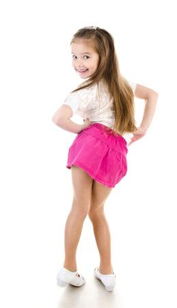 skirts: Adorable niña feliz posando vista posterior aislado en un blanco Foto de archivo