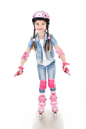 active girl: Cute smiling little girl in pink roller skates and protective gear isolated on a white Stock Photo