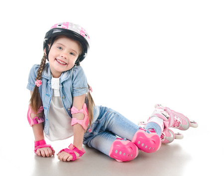 rollerblade: Cute smiling little girl in pink roller skates and protective gear isolated on a white Stock Photo