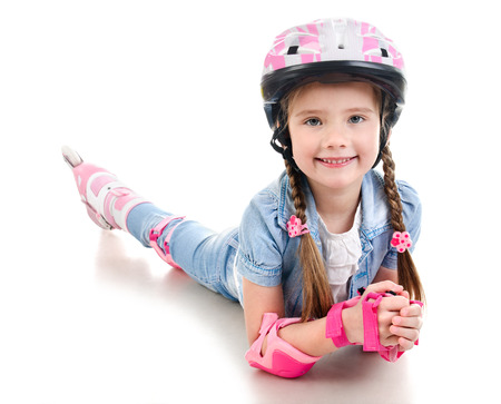kneepad: Cute smiling little girl in pink roller skates and protective gear isolated on a white Stock Photo