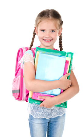 schoolgirl in uniform: Portrait of smiling schoolgirl with school bag and books isolated on a white background Stock Photo