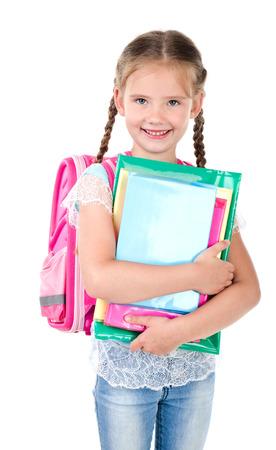 colegiala: Retrato de colegiala sonriendo con bolsa de la escuela y los libros aislados sobre un fondo blanco