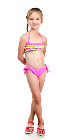 white girl: Cute smiling little girl in swimsuit isolated on a white