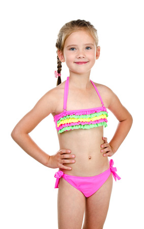 one little girl: Cute smiling little girl in swimsuit isolated on a white