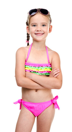 Cute smiling little girl in swimsuit and sunglasses isolated on a white