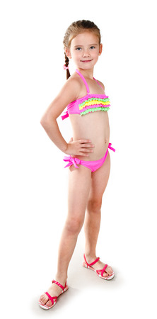 children swimsuit: Cute smiling little girl in swimsuit isolated on a white