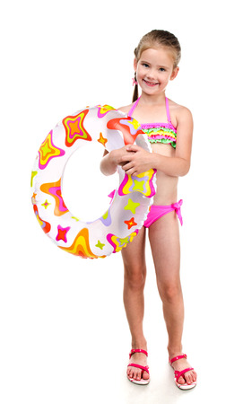 bathing suits: Cute smiling little girl in swimsuit with rubber ring isolated on a white Stock Photo