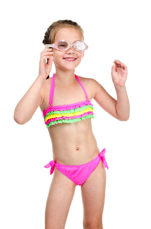 Cute happy little girl in swimsuit and glasses isolated on a white