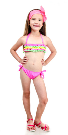 child swimsuit: Cute smiling little girl in swimsuit isolated on a white