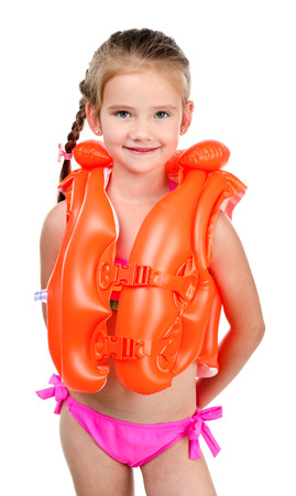 little girl bath: Cute happy little girl in life jacket and swimsuit isolated on a white Stock Photo