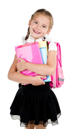 book bag: Portrait of smiling schoolgirl with backpack and books isolated on a white background Stock Photo