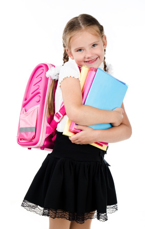 schoolgirl in uniform: Portrait of smiling schoolgirl with backpack and books isolated on a white background Stock Photo
