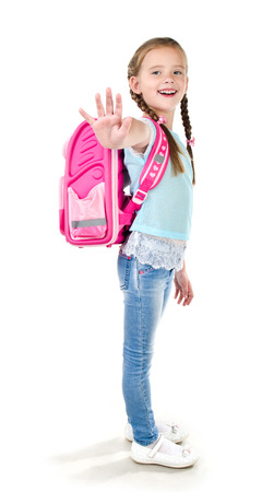 bye: Smiling schoolgirl with backpack saying good bye isolated on a white background