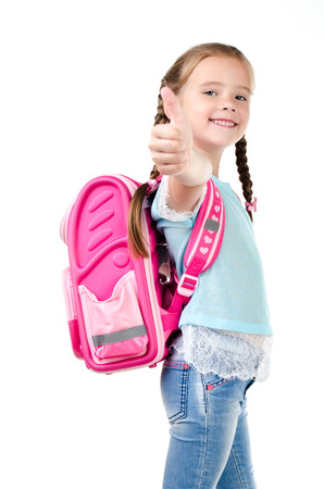 schoolgirl in uniform: Happy schoolgirl with backpack and finger up  isolated on a white background