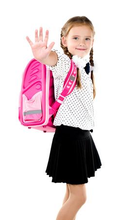 schoolgirl in uniform: Smiling schoolgirl with backpack saying good bye isolated on a white background