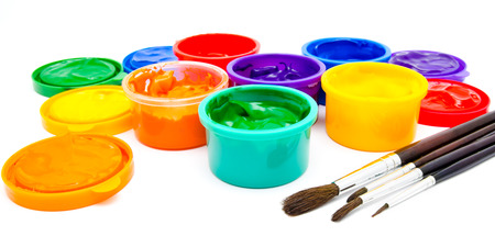 finger paint: Children finger paint and paintbrushes isolated on a white