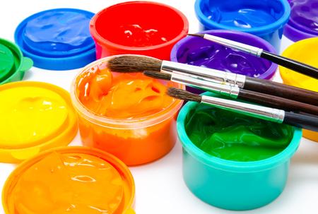 finger paint: Children finger paint and paintbrushes closeup