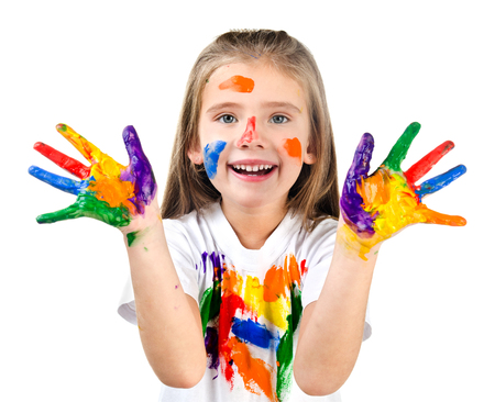 Happy cute little girl with colorful painted hands isolated on a white education concept