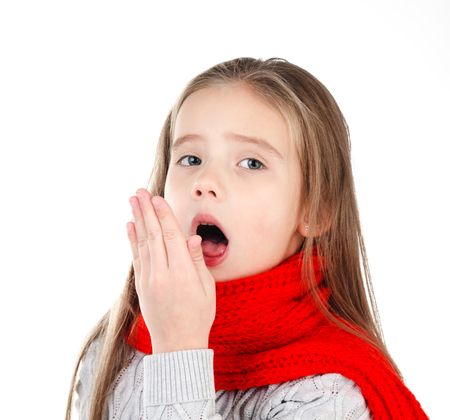 Sick little girl in red scarf coughing isolated on a white background Stock Photo