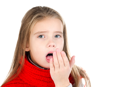 Sick little girl in red scarf coughing isolated on a white background Banco de Imagens