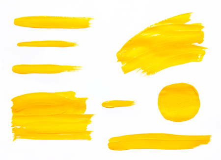 Paint brush strokes texture yellow watercolor isolated on a white background