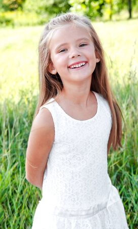 child laughing: Portrait of smiling cute little girl in summer day outdoor Stock Photo