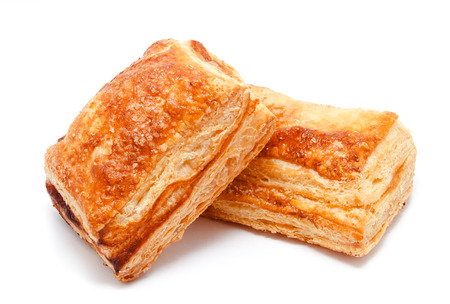 Fresh puff pastries isolated on a white background 免版税图像