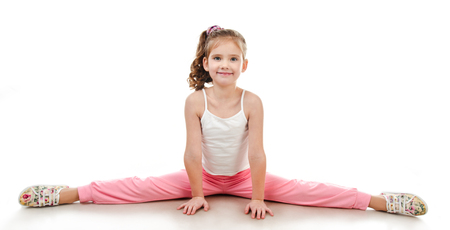 Cute little girl doing gymnastic exercise isolated on a white Stock Photo