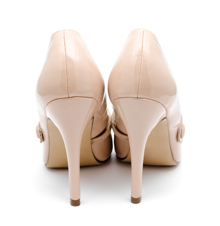 biege: Biege high heel woman shoes isolated on a white